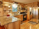 Prepare your favorite recipes in the fully equipped kitchen with stainless steel appliances.