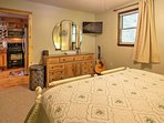 The master bedroom is located on the first floor of the cabin.