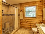 Rinse off in the tiled walk-in shower.