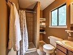 Relish in this bathroom's elegant walk-in shower.