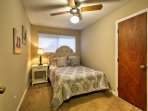 Another queen bed is available in this bedroom for a peaceful night of rest!