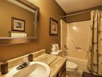 Freshen up for the day in this pristine bathroom!
