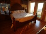Sunset warms the master suite; king bed and big rear view