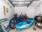 Store room with bikes and a double kayak, a BBQ and a few beach chairs for our guests to use