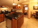 Granite countertops and knotty cherry cabinets with stained metal inserts