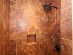 Amasing custom tile shower with rain shower head