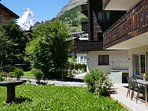 The garden apartment gives on to its own charming lawn and south facing deck with Matterhorn views.