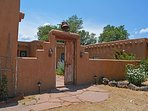 Traditional southwest adobe wall gated entry