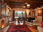 Large living room and dining area with mountain / pasture views and a 2nd wood burning kiva fireplace