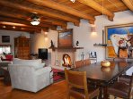Large upscale fireside dining table with sweeping pasture / mountain views