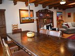 View from dining table to living area filled with fine art