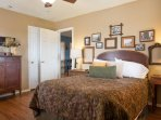 Just off the Family Room, this Queen bedroom has it's own bath and private entrance.