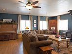 With a large coffee table perfect for playing board games, the family room is cozy and inviting.