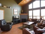 Living room overlooks the San Francisco Peaks, and features a gas fireplace, 42' flat-screen