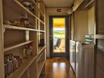 Pantry has a washer/dryer, detergent, dryer sheets and supply of coffee, tea and spices.