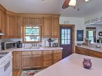 The kitchen has been updated with modern appliances and everything you'll need to prepare your favorite recipes.