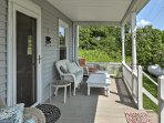 Watch the sunrise from the wonderful front porch while relaxing on the white wicker furniture.