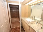 Completely remodeled guest bathroom with new cabinets and separate vanity area.