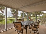 Savor a meal al fresco at this outdoor patio table overlooking the golf courses.