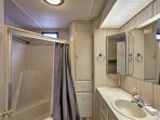 Wash up in this pristine bathroom located off the hall.