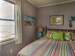 Rest your head on this queen bed after a day of fun in the sand and surf.
