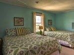 This bedroom offers 2 queen beds.