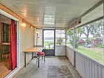 Enjoy the tranquil lake views from this screened-in porch.