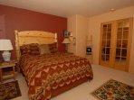 Bedroom 1 with Queen Denver Durango Mattress and tastefull Southwestern Bedding.  Log Furniture