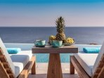 Have your morning coffee by the pool and gaze upon the blue horizon!
