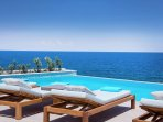 Lay by the pool while sunbathing and enjoy the magnificent sea views!