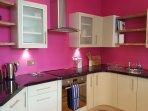 Fully equipped modern kitchen, including dishwasher, washer/dryer, full size fridge/freezer.