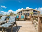 Large, shared oceanfront deck to enjoy meals by the ocean.