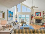 Oceanfront living room features a large flat screen TV, DVD, VCR, recliner, fireplace, and stereo/CD player with...