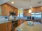Fully equipped kitchen with granite counter tops and stainless steel appliances.