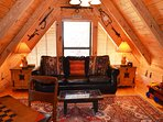 The loft with games and a game table is ready for you to create memories worth recreating