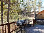 A grill, outdoor furniture and a hot tub is ready for you.