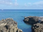 Climb down the ladder to enjoy snorkeling, scuba diving, paddle boarding and kayaking!