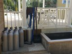 Tanks, weights and scuba gear rinse tank on site.