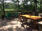 Deck off kitchen with harvest table and relaxing chairs