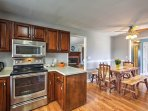This newly updated home features sleek laminate floors, modern amenities and stylish decor.