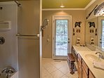 Freshen up in this spacious bathroom before heading out for the day.