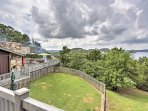 The property contains multiple decks and green grassy areas to enjoy.