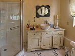 This bright bathroom is the perfect place to rinse off after a full day of activities.