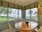 The 6-person dining room table is perfect for guests to enjoy meals at while looking out at the palm trees.