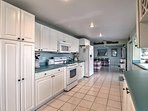Guests love the white cabinets that lines the entire kitchen.