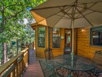 Gather around the outdoor table on the deck for a family barbecue.