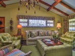 The vibrant living room is filled with one-of-a-kind pieces - from the vintage chandelier to each couch or chair you'll...