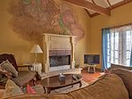 Sit back in the living room and admire the beautiful mural above the wood-burning fireplace.
