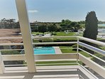 Long bright balcony with stunning views of the lake and gardens.