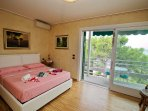 Large double bedroom with Lake View and breakfast table and chairs.